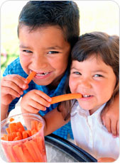 Kids eating carrots